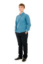 Happy smiling young man standing full length isolated on white background Royalty Free Stock Photo