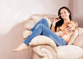 Happy smiling young woman chatting mobile phone relaxing big comfortable upholstered armchair Stock Image