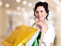 Happy smiling young woman with color bags. Stock Photo