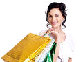 Happy smiling young woman with color bags looking at the camera isolated on white Stock Photos