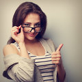Happy smiling young woman in glasses showing thumb up closeup v vintage portrait Royalty Free Stock Photography