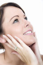 Happy Smiling Young Woman Hands on Face Looking Up Royalty Free Stock Photo