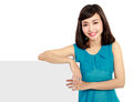 Happy smiling young woman showing blank signboard over white background Royalty Free Stock Image