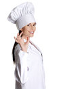 Happy, smiling young woman wearing chef's hat. Royalty Free Stock Photo