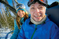 Happy snowboarding girls in winter mountains Stock Photography