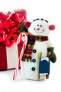 Happy snowman with gift sled and candy cane a a red holds a a Royalty Free Stock Image
