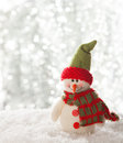 Happy snowman with lights in the background Stock Photography