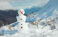 Happy snowman in mountains Royalty Free Stock Image