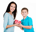 Happy son giving a gift to his mother isolated on white Stock Image