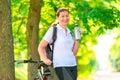 Happy sportswoman with a bottle of water