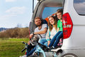 Happy sporty family sitting in the car boot Royalty Free Stock Photo