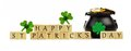 Happy st patricks day blocks with pot of gold over white wooden and shamrocks Royalty Free Stock Photography