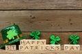 Happy St Patricks Day blocks with shamrocks and leprechaun hat Royalty Free Stock Photo