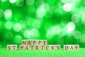 Happy St Patricks Day blocks with twinkling green background Royalty Free Stock Photo