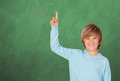 Happy student asking to speak green blackboard background Royalty Free Stock Photos