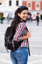 Happy student with backpack beautiful women looking at the camera smiling Royalty Free Stock Photography