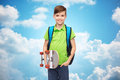 Happy student boy with backpack and skateboard Royalty Free Stock Photo