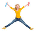 Happy student girl with books jumping Stock Image