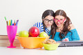 Happy student girls studying together cute teenage with eyeglasses looking at camera smiling Stock Photos
