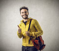 Happy student with his thumb up smiling putting Royalty Free Stock Photography