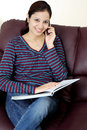 Happy student talking on cellphone Royalty Free Stock Images