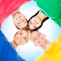 Happy students in colorful clothing standing together Royalty Free Stock Photo