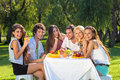 Happy students full of vitality eat a fruity meal Royalty Free Stock Photo