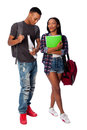 Happy students having fun joking smiling standing together talking carrying book bag backpack notepads on white Stock Photography