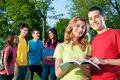 Happy students outdoor Stock Image