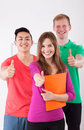 Happy students showing thumbs up sign Royalty Free Stock Photo