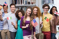 Happy students waving international flags Royalty Free Stock Photo