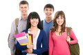 Happy students young teenager standing and smiling with books and bags Royalty Free Stock Photography