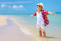 Happy stylish boy enjoys life on summer beach breeze tropical Royalty Free Stock Image