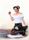 Happy about success beautiful pin up girl successful at bobbing for apples Stock Photo