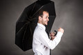 Happy success business man with an umbrella Stock Images