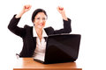 Happy successful lady manager at her desktop celebrating an achievement Royalty Free Stock Photography