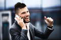 Happy successful young business man talking on cell phone Stock Images