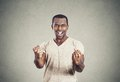 Happy successful young student man winning, fists pumped Royalty Free Stock Photo