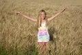 Happy summer girl in wheat field