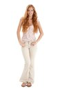 Happy summer portrait of redhead girl with long curly hair smiling at camera cutout on white Royalty Free Stock Photos