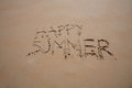 Happy summer text in sand beach Royalty Free Stock Photo