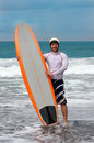 Happy surfing man on bali island Royalty Free Stock Photo
