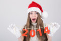 Happy surprised santa girl holding new year number decoration beautiful young caucasian christmas and celebration concept Stock Image