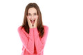 Happy surprised teen girl shocked and with hands on face looking at camera isolated on white Royalty Free Stock Photo