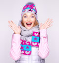Happy surprised woman in winter clothes with positive emotions photo of a bright at studio Stock Photo