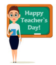 Happy Teacher`s Day. Cute teacher with pointer and notebook stands at the blackboard
