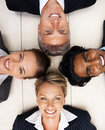 Happy team of colleagues while lying on the floor Stock Photo