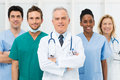 Happy team of doctors smiling and nurses at hospital Royalty Free Stock Photography