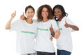 Happy team of volunteers giving thumbs up at camera on white background Stock Photo