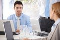 Happy team of young people working together businesspeople in bright office Stock Photo